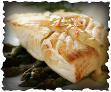 A fillet of halibut prepared for gourmet meal with asparagus.