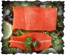 Wild Alaskan Salmon fillets in a bed of ice and fresh garnishing