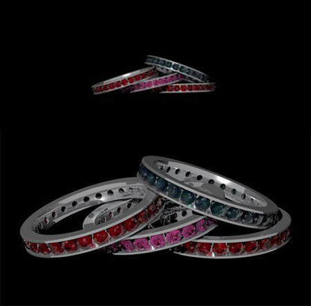 Custom 4-ring set with rubies, emeralds and pink diamonds designed by Massoud