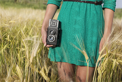 photographer in a field