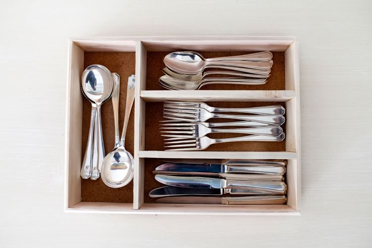 Reclaim Design's cutlery tray made from reclaimed wood containing silverware.
