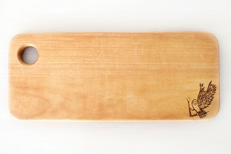 Reclaim Design's lazer etched breadboard made from reclaimed wood with owl design.