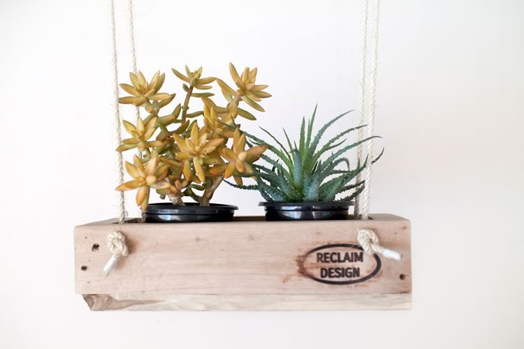 Reclaim Design's 2 pot hanging planter made from reclaimed wood with jute rope containing succulents.