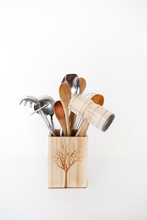 Reclaim Design's large lazer etched box made from reclaimed wood with tree design containing kitchen utensils.