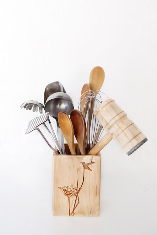 Reclaim Design's large lazer etched box made from reclaimed wood with humming bird design containing kitchen utensils.