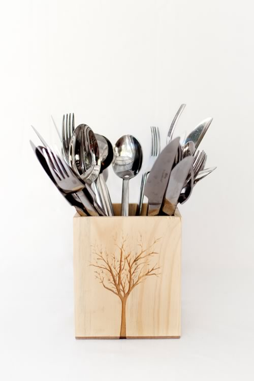 Reclaim Design's small lazer etched box made from reclaimed wood with tree design containing cutlery.