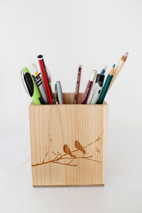 Reclaim Design's small lazer etched box made from reclaimed wood with birds on branch design containing stationery.