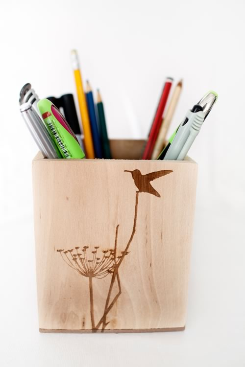 Reclaim Design's small lazer etched box made from reclaimed wood with humming bird design containing stationery.