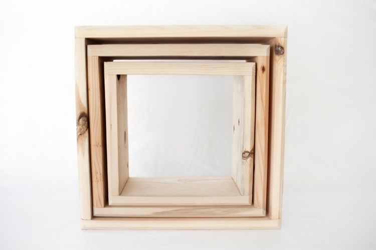 Reclaim Design's light wall mounted shadow box set made from reclaimed wood. Shown nested.