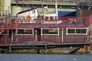 Picture The London Regalia was closed in approx 2011 and was towed downriver to West Silvertown where it currently remains disused and gradually decaying away.
